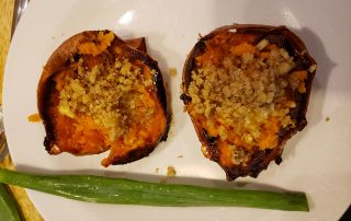 Baked sweet potato with crushed walnuts and ghee